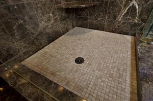 tile your shower floor, subfloor, Pre-pitching, Weep Holes, shower pan, waterproof membranes, Jacuzzi decks